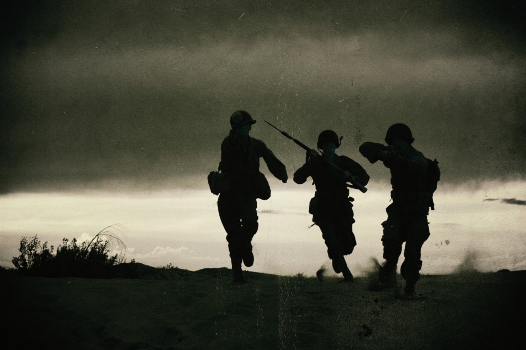 soldiers running against backlit sky